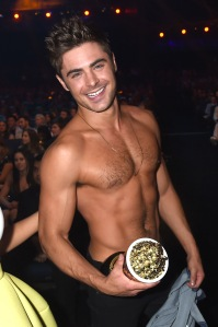 LOS ANGELES, CA - APRIL 13: Actor Zac Efron, winner of the Best Shirtless Performance award for 'That Awkward Moment,' attends the 2014 MTV Movie Awards at Nokia Theatre L.A. Live on April 13, 2014 in Los Angeles, California.  (Photo by Jeff Kravitz/FilmMagic)